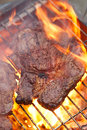 Food meat rib eye beef steak on party summer barbecue grill wi with flame shallow dof Stock Image