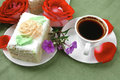Food milked cream cake with roses sweet and hot black coffee cup Royalty Free Stock Images