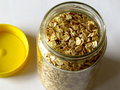 Food oatmeal in a glass jar on white background Royalty Free Stock Photos