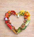 Food photography of heart made from different vegetables on old wooden table Royalty Free Stock Photo