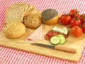 Food for picnic bread meat and vegetables on cutting board Royalty Free Stock Photography