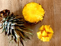 Food pineapple cut in small pieces placed on a glass bowl seen from above Stock Photography