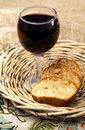 Food plate with bread and red wine in basket on a table Royalty Free Stock Photo