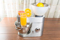 Food processor with citrus press squeezes juice Royalty Free Stock Image