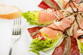 Food salmon anchovy salad smoked anchovies pepper and tuna spanish Stock Photos