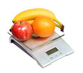 Food scale with fruits apple banana and orange isolated Royalty Free Stock Photo