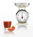 Food scale with tomato juice glass isolated on white background Royalty Free Stock Photo