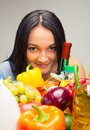Food set young girl with a basket full of goods Stock Images