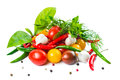 Food setting with fresh ripe red yellow black cherry tomatoes garlic pepper and greens is isolated on the white background Stock Images