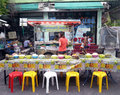 Food stall on the street yellow and red seat putting for enjoying open air meal Royalty Free Stock Image