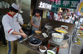 Food stand in xian muslim quarter local people cooking on the streets of china Stock Images