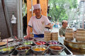 Food stand in xian muslim quarter local people cooking on the streets of china Royalty Free Stock Image