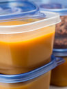 Food storage containers full of soup Royalty Free Stock Photography