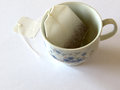 Food tea filter into tea cup on white background Royalty Free Stock Photos