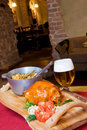 Food on wooden tray and beer Stock Photo
