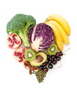 Foods with high nutritional value in a heartshape including red cabbage avocado and pomegranate Stock Photo