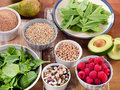 Foods rich in Fiber on wooden table. Royalty Free Stock Photo