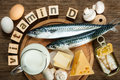 Foods rich in vitamin d natural as fish eggs cheese milk butter mushrooms canned sardines Royalty Free Stock Image