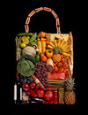 Foodstuff handbag studio photography of designer made from different fruits and vegetables on black background Stock Photography