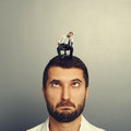 Foolish man with small bored man on the head portrait of Royalty Free Stock Image