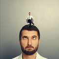 Foolish man with small smiley man on the head portrait of Royalty Free Stock Photos