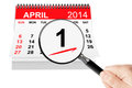 Fools day concept april calendar with magnifier on a white background Royalty Free Stock Photo