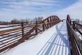 Foot and bike trail bridge in winter scenery south platte river at fort lupton colorado Stock Photos