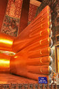 Foot detail of reclining buddha statue the golden toes inside buddhist temple wat po bangkok thailand Stock Photos