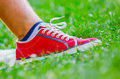 Foot of jogging person resting in the grass Stock Photo