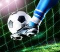 Foot kicking soccer ball Royalty Free Stock Photo
