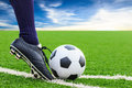 Foot kicking soccer ball on corner Royalty Free Stock Photos