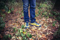 Foot Man walking on fall in the park on autumn leaves. Lifestyle