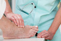 Foot massage a doctor massaging a patient s ill Stock Image