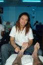 Foot Masseuse at work Pattaya Royalty Free Stock Photo