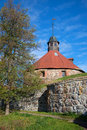 At the foot of the medieval round tower of Lars Torstensson. Korela Fortress, Priozersk. Russia Royalty Free Stock Photo