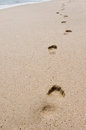 Foot print on beach several prints a Royalty Free Stock Photography