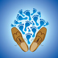 Foot prints and  pair of grungy shoe Royalty Free Stock Photo