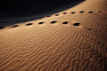Foot prints on Sand Dunes Stock Photo