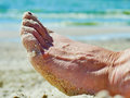 Foot in the sand on the beach Royalty Free Stock Photo