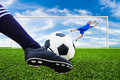 Foot shooting soccer ball to goal penalty Stock Photos