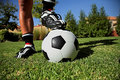 Foot on a soccerball Stock Photography
