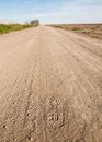 Foot Step in a dusty country road Royalty Free Stock Photo