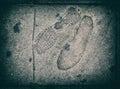 Foot steps on footpath asphalt texture