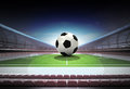 Football ball in midfield of magic stadium own design Royalty Free Stock Photo