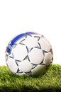 Football ball soccer is lying on grass on field Royalty Free Stock Images