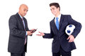 Football bet dispeased businessman paying a lost to a happy rival over a game Royalty Free Stock Images