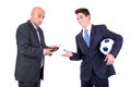 Football bet dispeased businessman paying a lost to a happy rival over a game Royalty Free Stock Image
