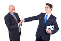 Football bet dispeased businessman paying a lost to a happy rival over a game Royalty Free Stock Photos
