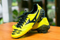 Football boots soccer boots yellow color on wood table Royalty Free Stock Photo