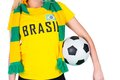 Football fan in brasil tshirt holding ball on white background Royalty Free Stock Image